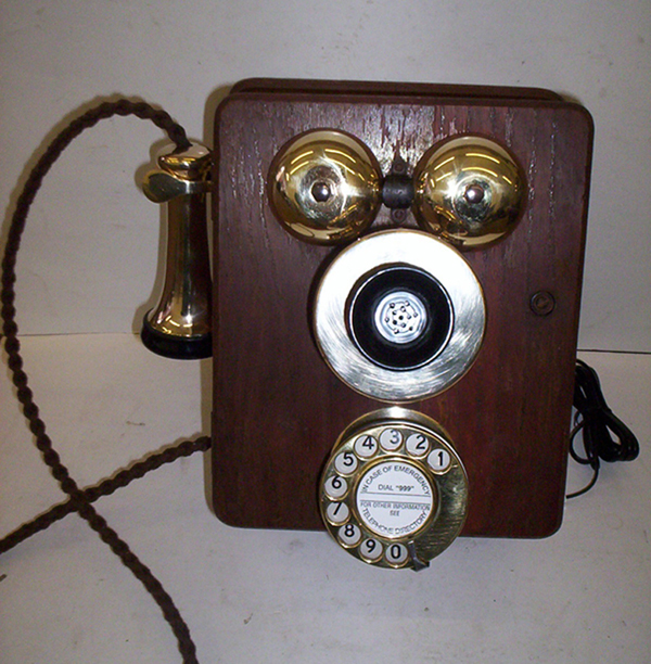 Original wood wall telephone with new brass fittings