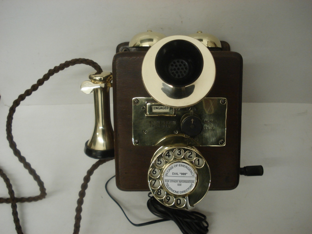 Original wood wall phone with new brass fittings and magneto