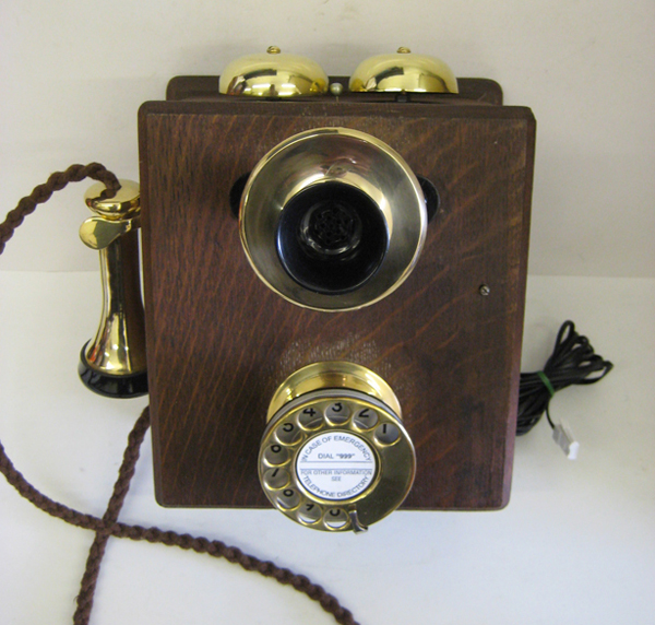 Original wood wall phone with new brass fittings.